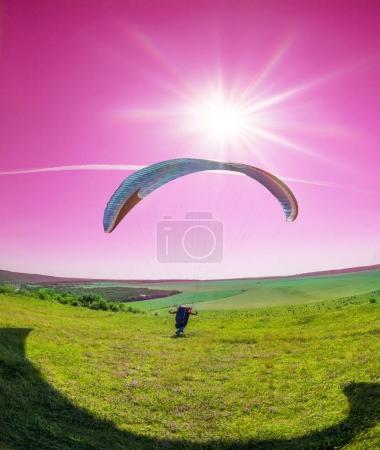 Air paragliding under the Sun