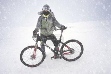 Journey with a mountain bike in a snow storm