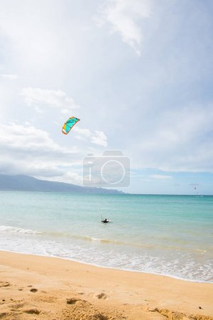 Kite surfer at the empty beach on the island of Maui, Hawaii
