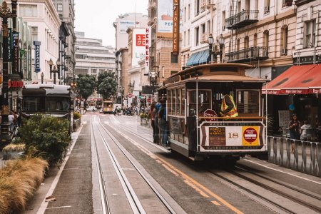 Classical cable car or a tram on the streets of San Francisco making classical u turn, USA. August 20, 2017.