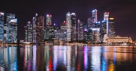 August 30, 2017. Singapore night panorama view of many skyscrapers by the water.