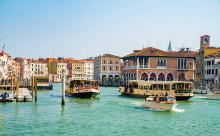 Venice, Italy. April 12, 2018. Beautiful Venice narrow canals, with many classic gondolas, amazing old rusty buildings, near old cathedral of Santa Maria della Salute.