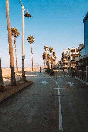Beautiful Venice beach area in Los Angeles. Bicycles road down the ocean near the beach. Beautiful Californian spirit.