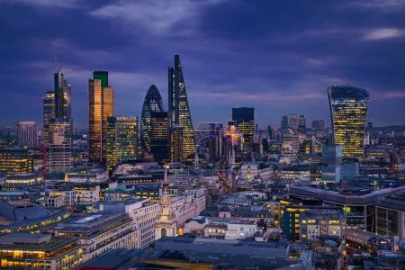 Photo for London, England - Panoramic skyline view of Bank district of London with the skyscrapers of Canary Wharf at the background at blue hour - Royalty Free Image