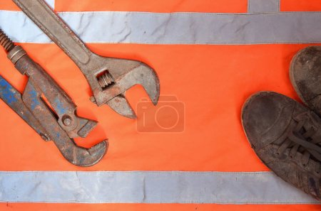 Adjustable and pipe wrenches against the background of an orange