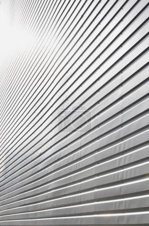 The texture of the wall is made of metal coating of huge aluminu