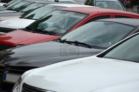 Roofs of several cars. A lot of cars stand close at rush hour