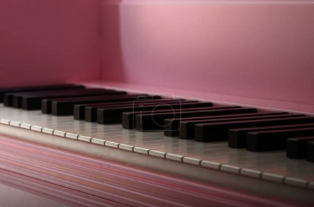 Close-up of the keyboard of a pink piano. Set of white and black buttons