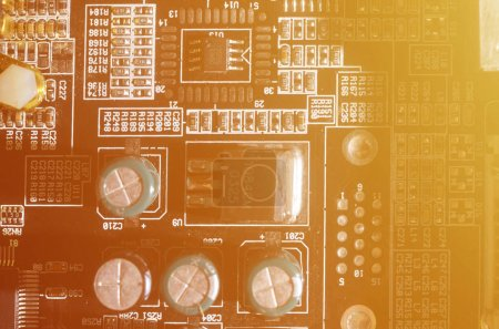 Photo for A toned macro image of a computer board with many small technological elements. Extremely shallow depth of field. Abstract technological background - Royalty Free Image