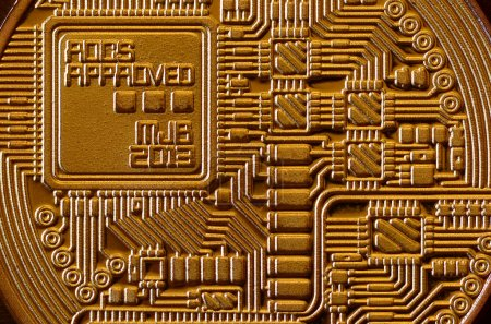 Macro photography of a golden yellow metal bitcoin. Close up shiny metal texture. Abstract business and modern technology background. Cryptocurrency mining concept