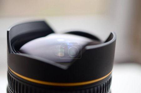 Fragment of a wide angle lens for a modern SLR camera. A photograph of a fisheye lens with a minimal focal length