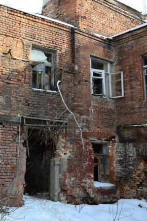 Fragment of an abandoned two-story building after military operations in Donetsk