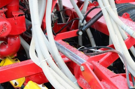Springs and tubes are arranged in a row. A row of seeder. Heavy