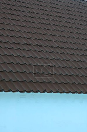 Brown metal roof tiles. Metal Roof Shingles - Roofing Construction