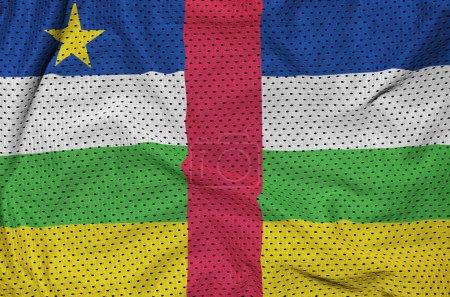 Photo pour Drapeau de la République centrafricaine imprimé sur un tissu de maille de vêtements de sport en nylon polyester avec quelques plis - image libre de droit