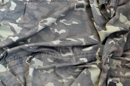 Photo for Camouflage background texture as backdrop for russian or ussr snipers design projects. Back side of snipers camouflage jacket with many pleats on crumpled fabric - Royalty Free Image