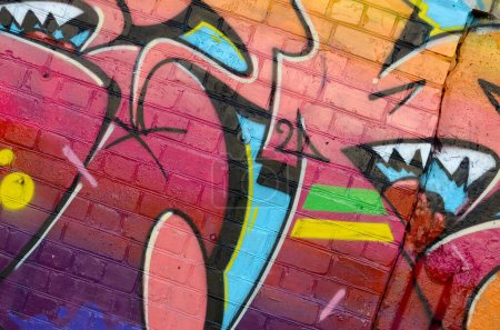 Abstract colorful fragment of graffiti paintings o...