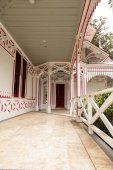 Red and white porch of a Victoria cottage