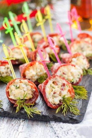 Appetizers with smoked sausage and cheese for buff...