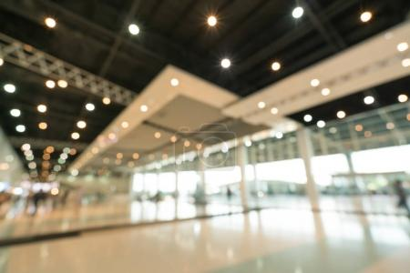 Photo for Public event exhibition hall, blurred bokeh defocused background, business trade show or modern interior architecture concept - Royalty Free Image