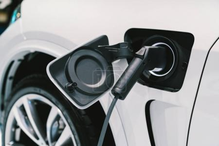 Photo for Electric Vehicle charging system. EV fuel for advanced hybrid car. Modern automobile technology or advanced energy concept - Royalty Free Image