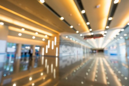 Photo for Blurred, defocused bokeh background of grand hallway, exhibition hall, or trade show event. International convention center, modern interior architecture, or commercial tradeshow organizer concept - Royalty Free Image