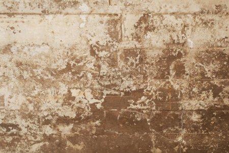 Photo pour Texture des coffrages en bois gravé sur un mur de béton de grunge comme toile de fond - image libre de droit