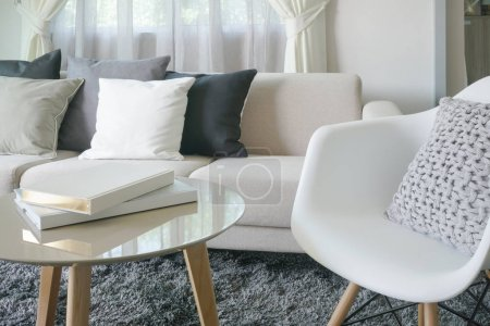 Photo for Armchair and sofa with pillows in modern style interior living room - Royalty Free Image