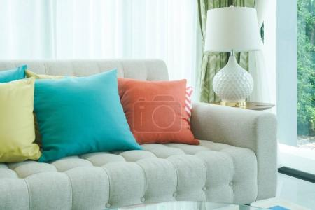Photo for Colorful pillows on sofa in living room - Royalty Free Image