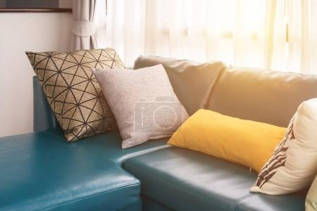 Photo for Modern living room with green leather sofa and pillows in the morning - Royalty Free Image