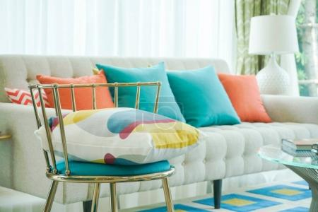 Photo for Closeup pillow on vintage chair with sofa in living room - Royalty Free Image