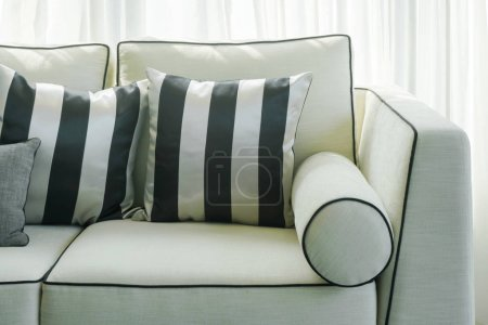 Photo for Black and white stripped pillows on sofa in living room - Royalty Free Image
