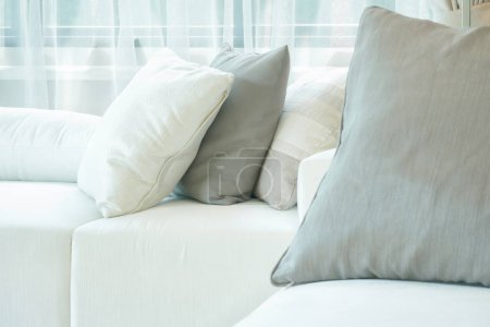 Photo for Gray and white pillow on white sofa in living room - Royalty Free Image