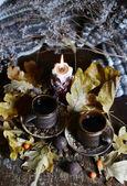 """Постер, картина, фотообои """"Коричневые керамические кофейные чашки. Горит свеча."""""""