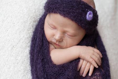 baby sleeping  in  blanket.