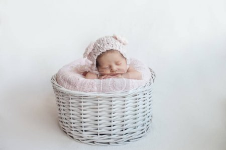 Newborn baby asleep in basket