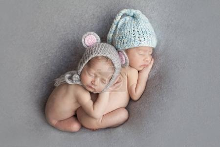 Newborn baby boy and girl twins