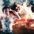 Angry man holding a wrench with his house on fire ...