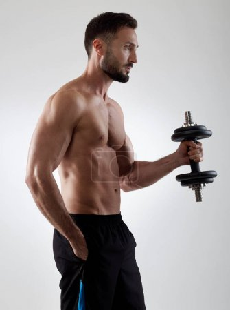 Sportsman with dumbbell