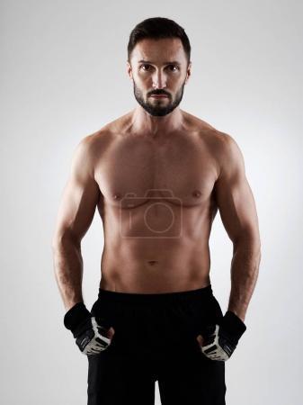 Muscular man on grey
