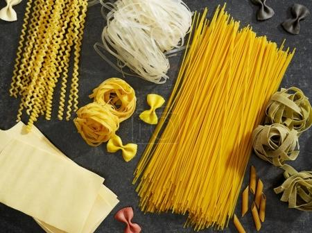 Photo for Raw pasta on kitchen counter top - Royalty Free Image