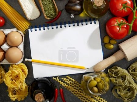 Notebook, pasta and ingredients