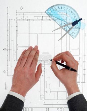 Architect designing a blueprint