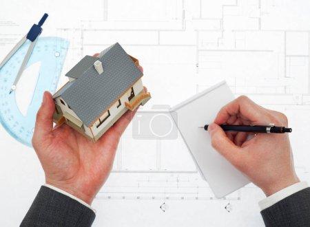 Architect taking notes
