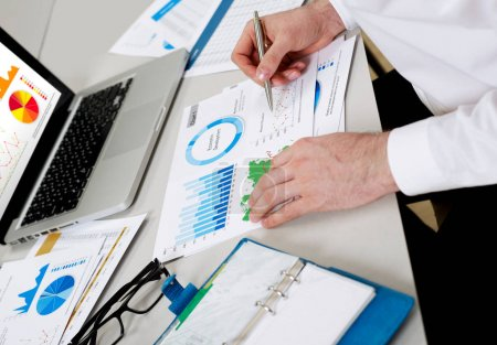 Photo for Businessman reviewing financial situation - Royalty Free Image