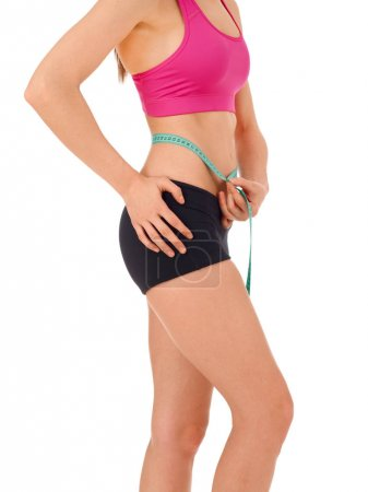 Slim woman with tape measure around her waist