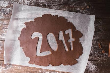 Christmas background. 2017 written with Chocolate dough on a wooden background