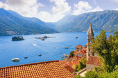 Beautiful autumn Mediterranean landscape. Montenegro, Adriatic Sea, Kotor Bay. View of ancient town of Perast, belltower of Church of Our Lady of Rosary, Island of Our Lady of the Rocks, Island of Saint George. Travel and tourism concept