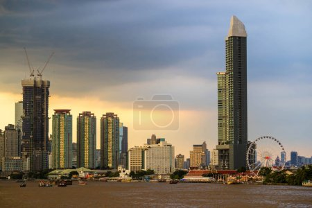 Bangkok skyline cityscape. Buildings, river and boat transport