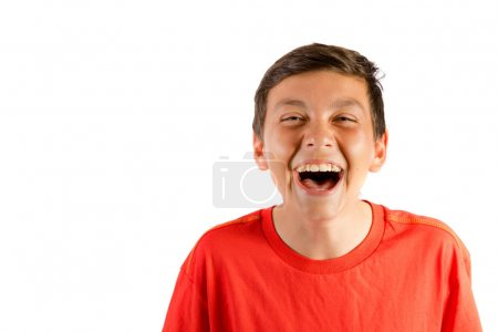 Young teenage boy isolated on white roaring with laughter